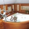 Ванна кімната в дерев'яному будинку: популярні способи обробки