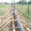 Стрічковий фундамент під паркан